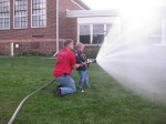 Ethan Spraying Water Hose