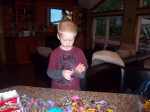 My brother Aiden assembling candy packs to give away at the kickoff